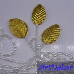 Листик из ткани золотистого цвета, на ножке из гибкой проволоки